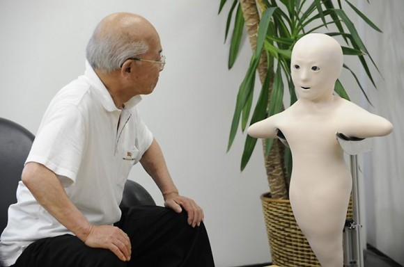 An elderly man (L) communicates with his