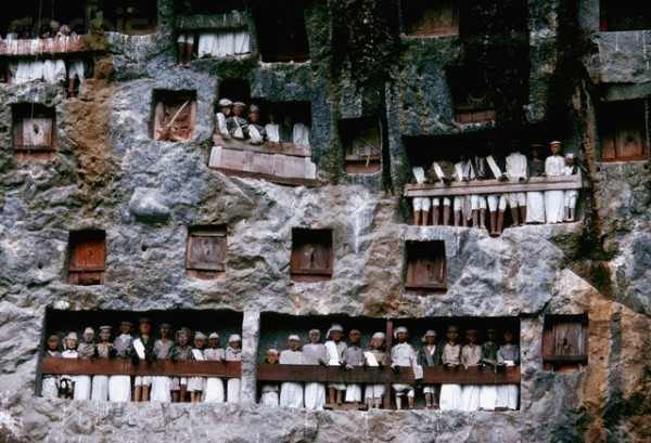 Sculptures of People on Hanging Graves