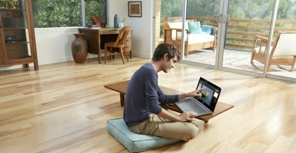 Man Using Notebook in Living Room